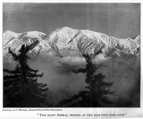 """The giant Sierras, fringed at the base with dark pines"""
